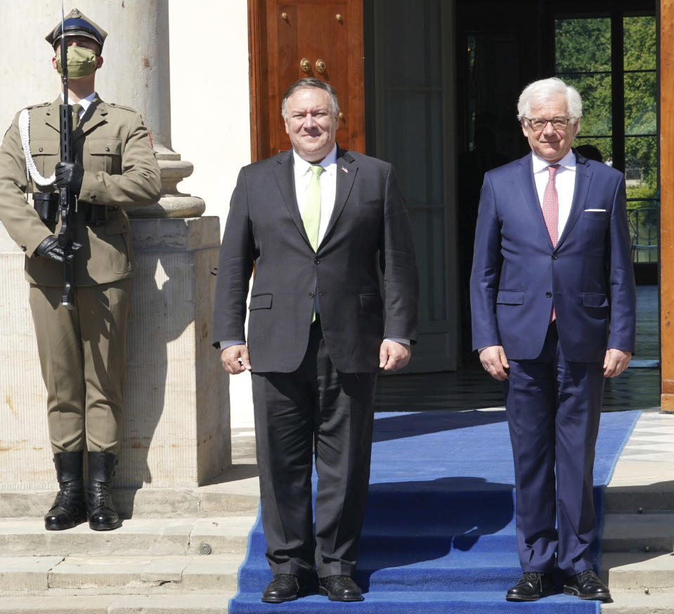 US Secretary of State Mike Pompeo, left, meets with Poland's Foreign Minister Jacek Czaputowicz in Lazienki Palace in Warsaw, Poland, Saturday Aug. 15, 2020. Pompeo is on a five day visit to central Europe. (Janek Skarzynski/Pool via AP)