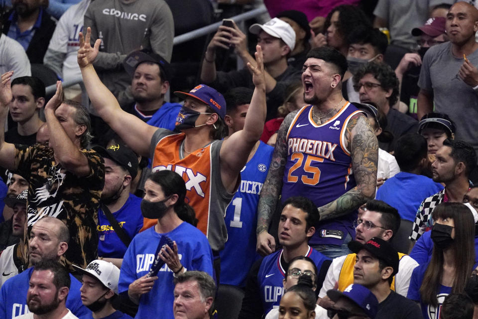 Phoenix Suns fans cheer during the second half in Game 6 of the NBA basketball Western Conference Finals between the Los Angeles Clippers and the Suns Wednesday, June 30, 2021, in Los Angeles. (AP Photo/Mark J. Terrill)