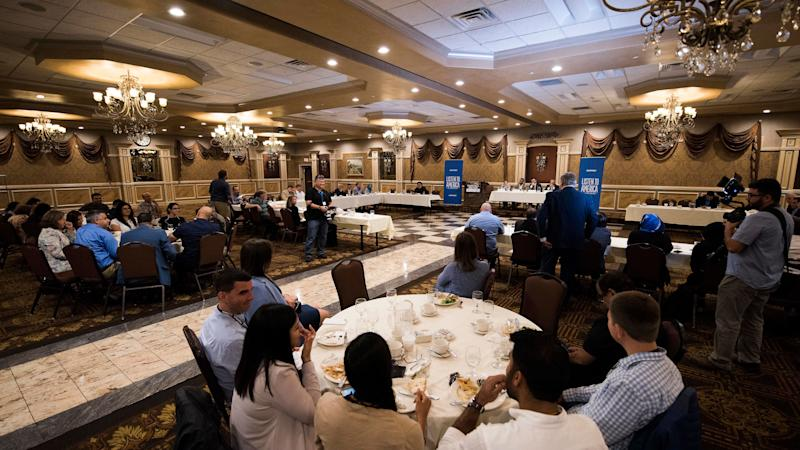 """Audience members listen during the """"How the Arab and Muslim Community Is Still Coping After 9/11"""" event at Byblos Banquet Hall in Dearborn, Michigan."""