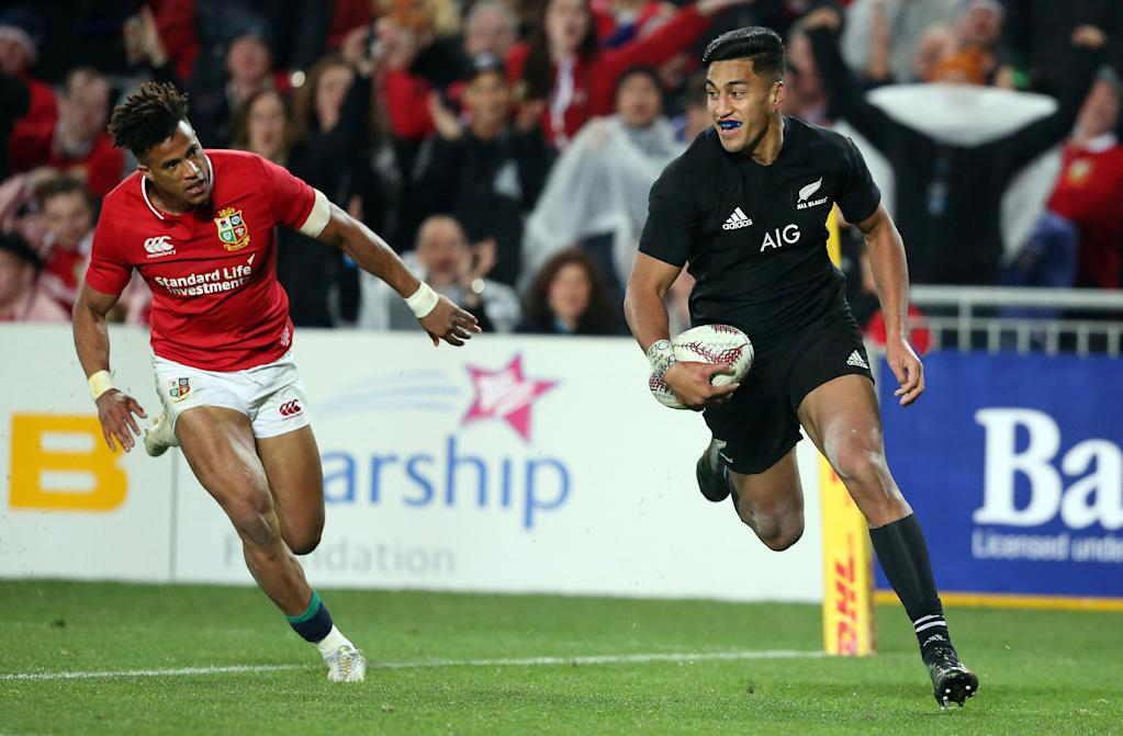 (FILES) This file photo taken on June 24, 2017 shows New Zealand All Blacks player Rieko Ioane (R) scoring a try in front of Anthony Watson of the British and Irish Lions during the first Test match at Eden Park in Auckland.A stranded British and Irish Lions supporter has told how a stranger's act of kindness resulted in him bunking down at the home of All Black sensation Rieko Ioane and his brother Akira. The stranger was the Ioane's mother Sandra, who took pity on Lions fan Alex Edwards when he turned up at the Ponsonby Rugby Club in Auckland where she works asking to park his van overnight. (AFP Photo/MICHAEL BRADLEY)