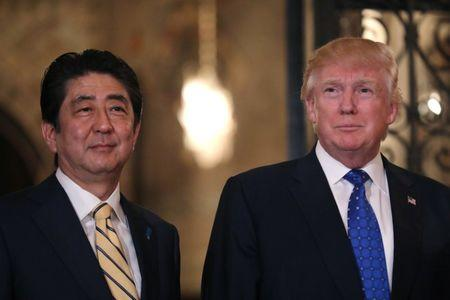 Japanese Prime Minister Shinzo Abe and U.S. President Donald Trump pose for a photograph before attending dinner at Mar-a-Lago Club in Palm Beach, Florida, U.S.