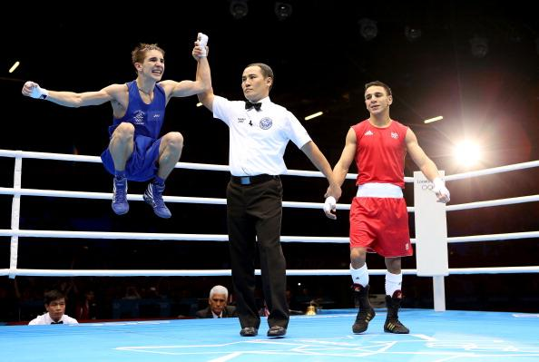 LONDON, ENGLAND - AUGUST 07:  Michael Conlan of Ireland (L) celebrates his victory over Nordine Oubaali of France during the Men's Fly (52kg) Boxing on Day 11 of the London 2012 Olympic Games at ExCeL on August 7, 2012 in London, England.  (Photo by Scott Heavey/Getty Images)