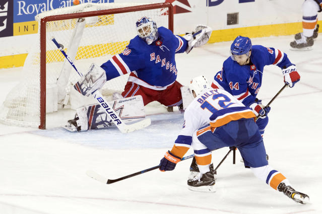 New York Islanders right wing Josh Bailey (12) scores the winning goal past New York Rangers goaltender Henrik Lundqvist (30) during the third period of an NHL hockey game, Thursday, Jan. 10, 2019, at Madison Square Garden in New York. (AP Photo/Mary Altaffer)