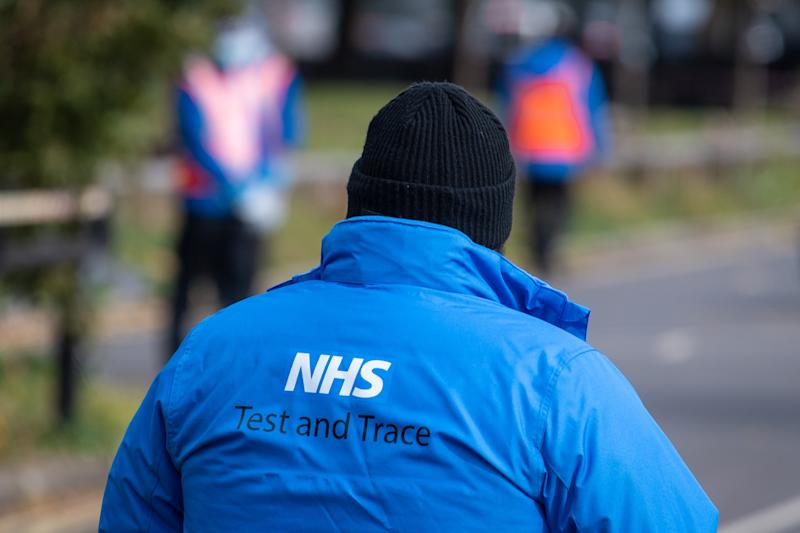 An NHS Test and Trace logo on a member of staff's jacket at a Covid-19 testing centre in Southwark, south London, after a range of new restrictions to combat the rise in coronavirus cases came into place in England. (Photo by Dominic Lipinski/PA Images via Getty Images)