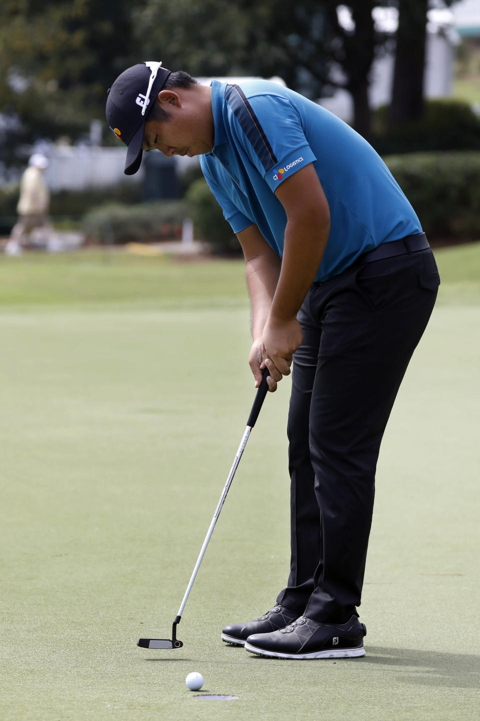 Byeong Hun An, of South Korea, strokes a birdie putt on the 10th green during the second round of the Sanderson Farms Championship golf tournament in Jackson, Miss., Friday, Sept. 20, 2019. (AP Photo/Rogelio V. Solis)