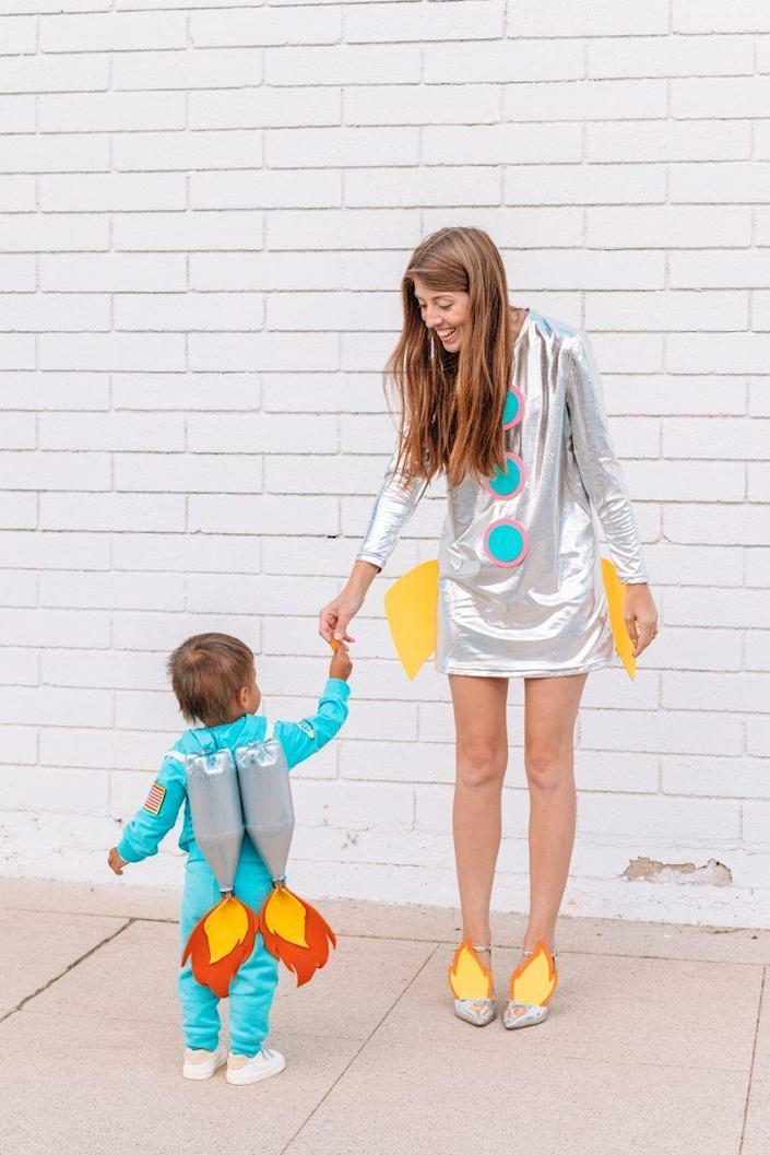 """<p>Three, two, one, blast off! You and your daughter will look out of this world this Halloween as a modern and bright rocket ship and astronaut. You can use old soda bottles to create the astronaut's backpack. Clever! </p><p><strong>See more at <a href=""""https://studiodiy.com/diy-space-family-costume/"""" rel=""""nofollow noopener"""" target=""""_blank"""" data-ylk=""""slk:Studio DIY!"""" class=""""link rapid-noclick-resp"""">Studio DIY!</a>.</strong></p><p><a class=""""link rapid-noclick-resp"""" href=""""https://www.amazon.com/gp/product/B07BN56RHL/ref=as_li_ss_tl?tag=syn-yahoo-20&ascsubtag=%5Bartid%7C2164.g.37079496%5Bsrc%7Cyahoo-us"""" rel=""""nofollow noopener"""" target=""""_blank"""" data-ylk=""""slk:SHOP SPACE PATCHES"""">SHOP SPACE PATCHES</a></p>"""