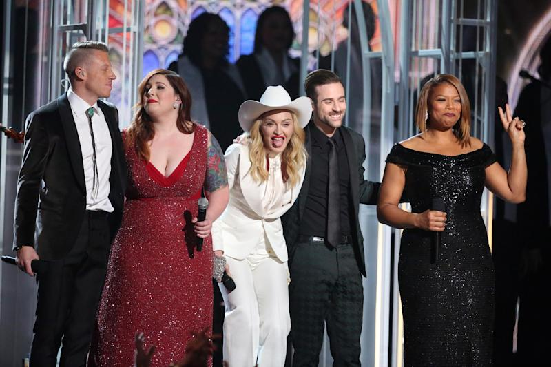 "Performers, from left, Macklemore, Mary Lambert, Madonna, Ryan Lewis and Queen Latifah appear on stage during a performance of ""Same Love"" at the 56th annual Grammy Awards at Staples Center on Sunday, Jan. 26, 2014, in Los Angeles. (Photo by Matt Sayles/Invision/AP)"