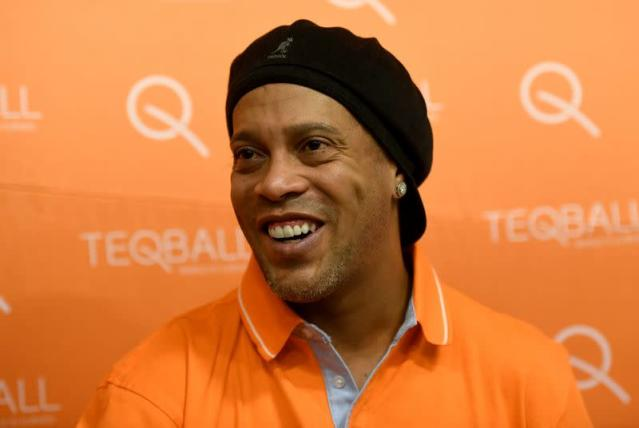 FILE PHOTO: Former FIFA player of the year and football World Cup winner Ronaldinho of Brazil listens during an interview with Reuters at the Teqball World Championships in Budapest