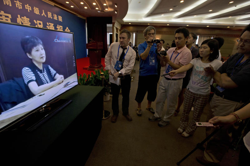 Journalists watch an online pre-recorded testimony by Gu Kailai, wife of former Chinese politician Bo Xilai before a press conference held at a hotel near the Jinan Intermediate People's Court in Jinan, eastern China's Shandong province on Friday, Aug. 23, 2013. Bo is accused of corruption and interference in the investigation of his wife's murder of a British businessman. (AP Photo/Ng Han Guan)