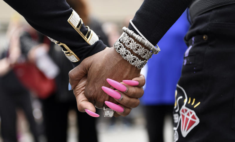 Michael Jackson fans join hands outside his final resting place at Forest Lawn Cemetery, Tuesday, June 25, 2019, in Glendale, Calif. Tuesday marks the 10th anniversary of Jackson's death. (Photo by Chris Pizzello/Invision/AP)