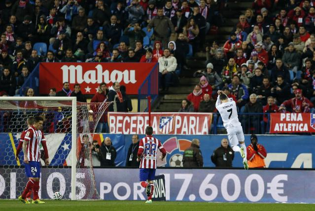 Real Madrid's Cristiano Ronaldo (7) celebrates his goal against Atletico Madrid during their Spanish King's Cup semi-final second leg soccer match at Vicente Calderon stadium in Madrid February 11, 2014. REUTERS/Susana Vera (SPAIN - Tags: SPORT SOCCER TPX IMAGES OF THE DAY)