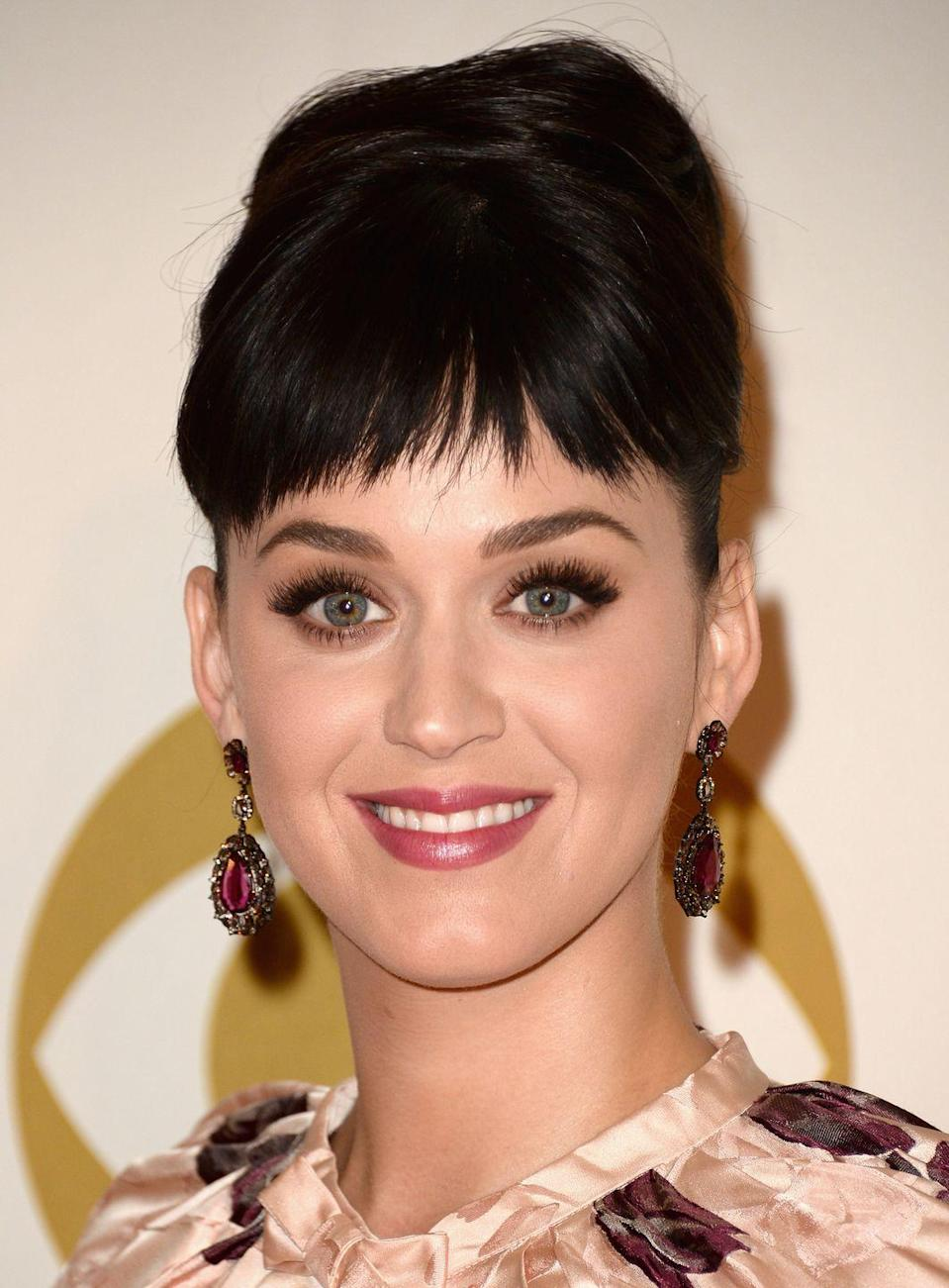 """<p>Get that Katy Perry look — perfect for weddings, special occasions, and more — with short, cute bangs and <a href=""""https://www.goodhousekeeping.com/beauty/hair/advice/g5172/wedding-updos/"""" rel=""""nofollow noopener"""" target=""""_blank"""" data-ylk=""""slk:simple updo"""" class=""""link rapid-noclick-resp"""">simple updo</a>.</p><p><strong>RELATED: </strong><a href=""""https://www.goodhousekeeping.com/beauty/hair/tips/g1646/wedding-guest-hair-styles/"""" rel=""""nofollow noopener"""" target=""""_blank"""" data-ylk=""""slk:25 Easy Wedding Guest Hairstyles for Every Dress Code"""" class=""""link rapid-noclick-resp"""">25 Easy Wedding Guest Hairstyles for Every Dress Code</a></p>"""