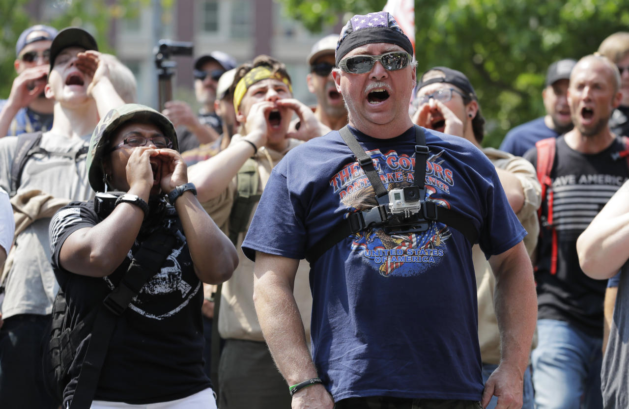 Supporters of a rally held by members of Patriot Prayer and other groups advocating for gun rights yell and cheer, Saturday, Aug. 18, 2018, at City Hall in Seattle. (AP Photo/Ted S. Warren)