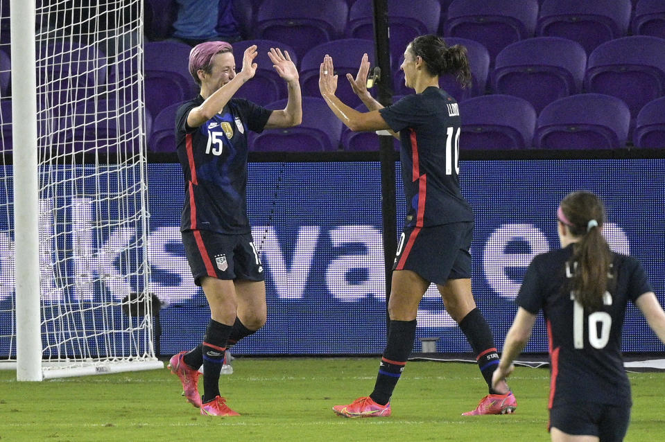 United States forward Megan Rapinoe (15) celebrates with forward Carli Lloyd (10) after Rapinoe score her second goal during the first half of a SheBelieves Cup women's soccer match against Argentina, Wednesday, Feb. 24, 2021, in Orlando, Fla. (AP Photo/Phelan M. Ebenhack)