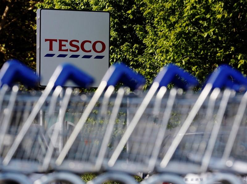 File photographs shows shopping trolleys lined up at a Tesco supermarket in London