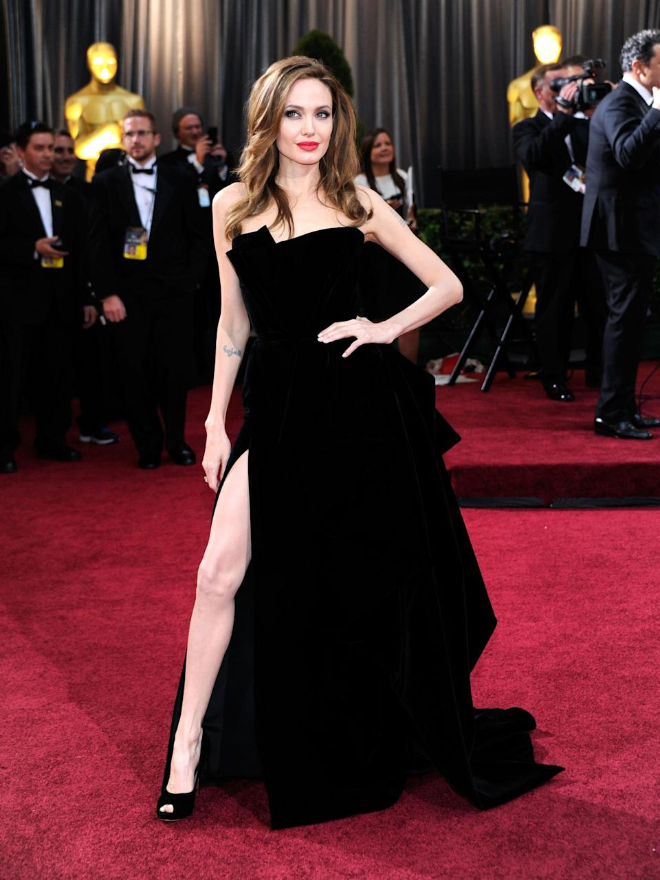 Angelina's tumbling, strapless Versace gown was a huge hit in 2012 – largely because the thigh-high split showcased the star's right leg. Angelina's 'leg-thrust' quickly went viral and even scored its own Twitter account.