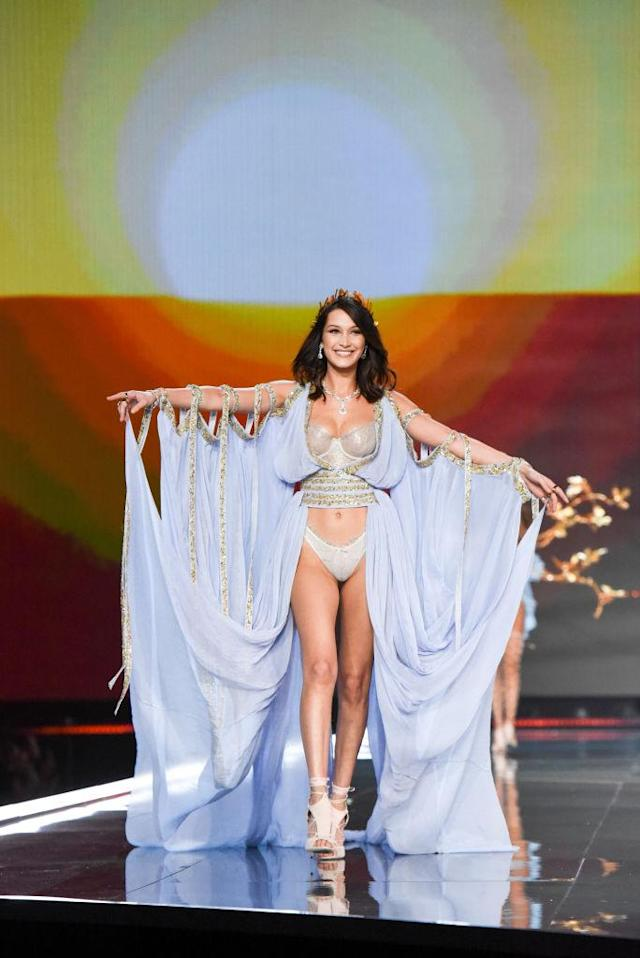 The model walked with her arms out down the runway. (Photo: Getty Images)