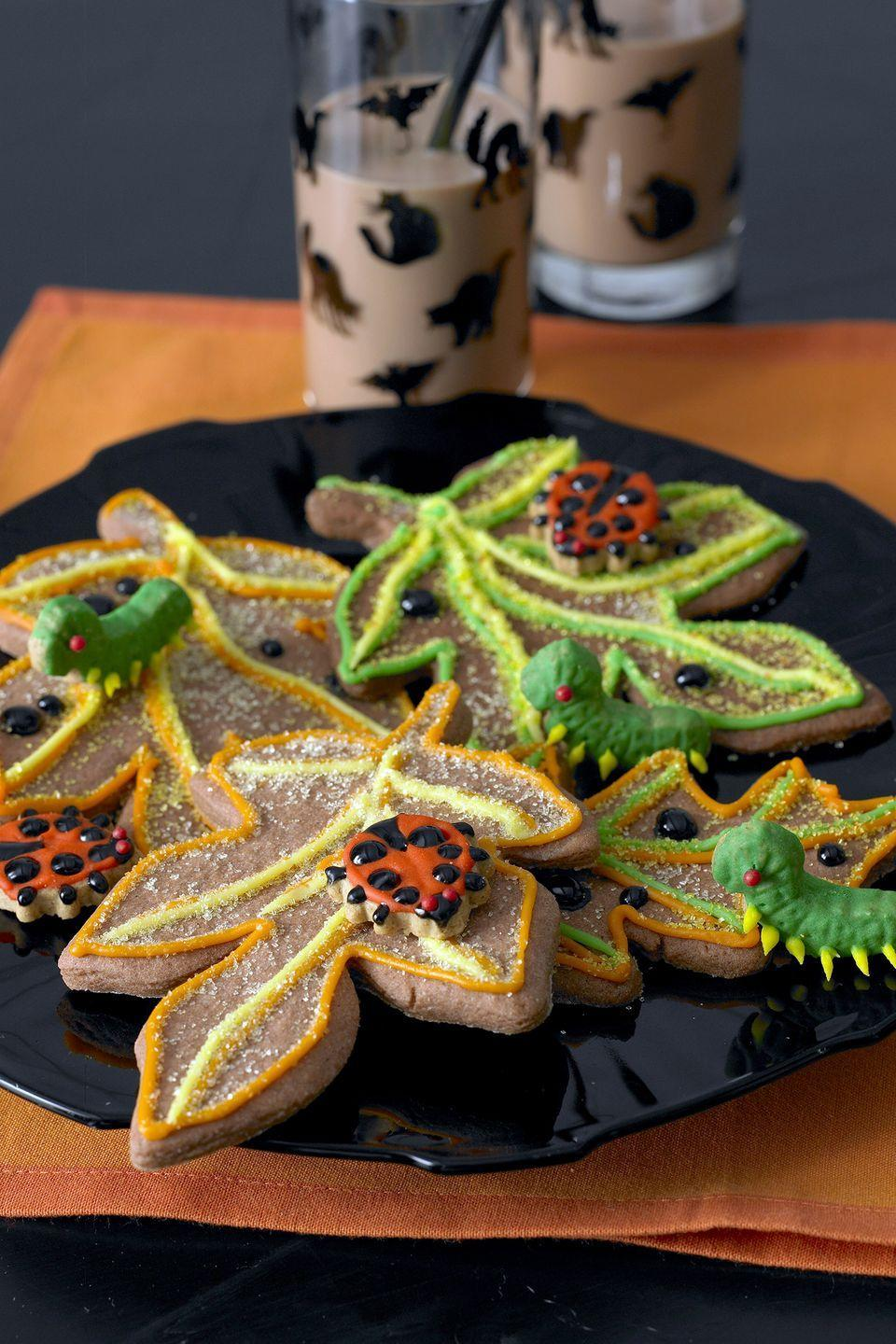 """<p>You'll need assorted sizes of <a href=""""https://www.amazon.com/Fall-Leaves-Cookie-Cutter-Recipe/dp/B074V1JVP7?tag=syn-yahoo-20&ascsubtag=%5Bartid%7C10070.g.2499%5Bsrc%7Cyahoo-us"""" rel=""""nofollow noopener"""" target=""""_blank"""" data-ylk=""""slk:leaf-shaped cookie cutters"""" class=""""link rapid-noclick-resp"""">leaf-shaped cookie cutters</a> to make these creepy crawly treats.</p><p><a href=""""https://www.womansday.com/food-recipes/food-drinks/recipes/a9947/buggy-leaf-spice-cookies-121371/"""" rel=""""nofollow noopener"""" target=""""_blank"""" data-ylk=""""slk:Get the recipe for Buggy Leaf Spice cookies."""" class=""""link rapid-noclick-resp""""><strong><em>Get the recipe for Buggy Leaf Spice cookies.</em></strong></a></p>"""