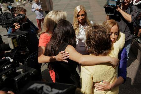Attorney Gloria Allred embraces several former Houston Texans cheerleaders outside of NFL headquarters in New York, U.S., June 4, 2018. REUTERS/Lucas Jackson