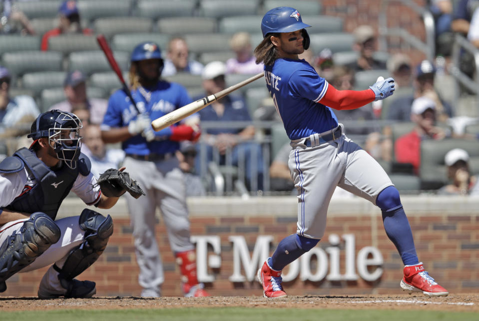 Toronto Blue Jays' Bo Bichette swings for a two run double in the ninth inning of a baseball game against the Atlanta Braves Thursday, May 13, 2021, in Atlanta. (AP Photo/Ben Margot)