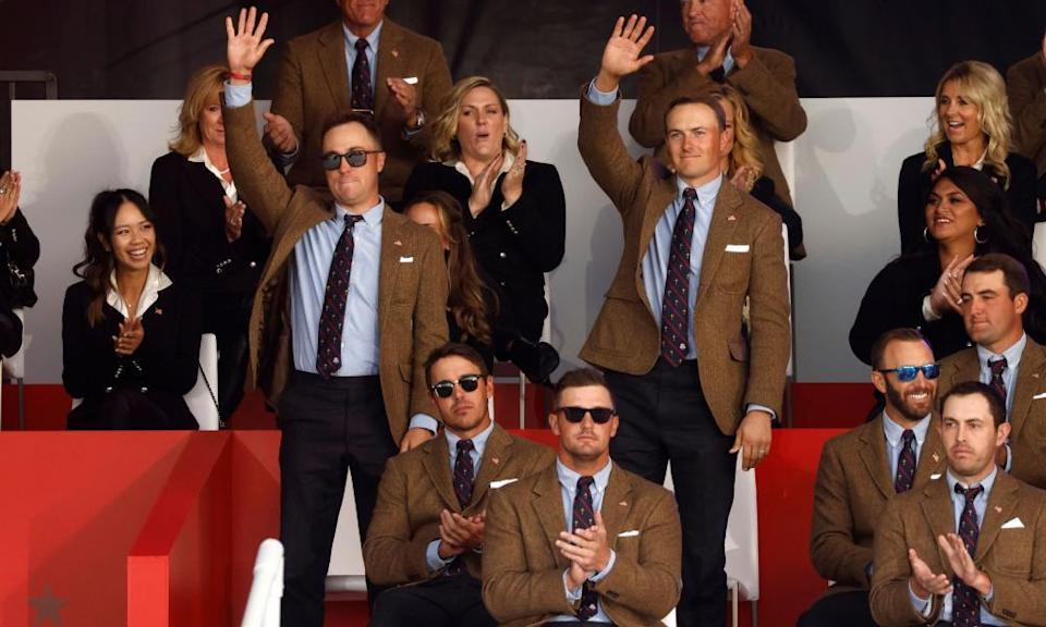 Team USA's Justin Thomas and Jordan Spieth wave to the crowd during the opening ceremony.