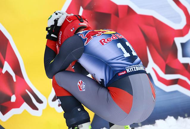 Third placed Bode Miller squats at the end of an alpine ski, men's World Cup downhill, in Kitzbuehel, Austria, Saturday, Jan. 25, 2014. (AP Photo/Giovanni Auletta)