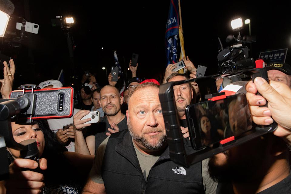 """Alex Jones is mobbed at the Maricopa County Elections office in Phoenix, on Nov. 5, 2020.<span class=""""copyright"""">Sinna Nasseri for TIME</span>"""