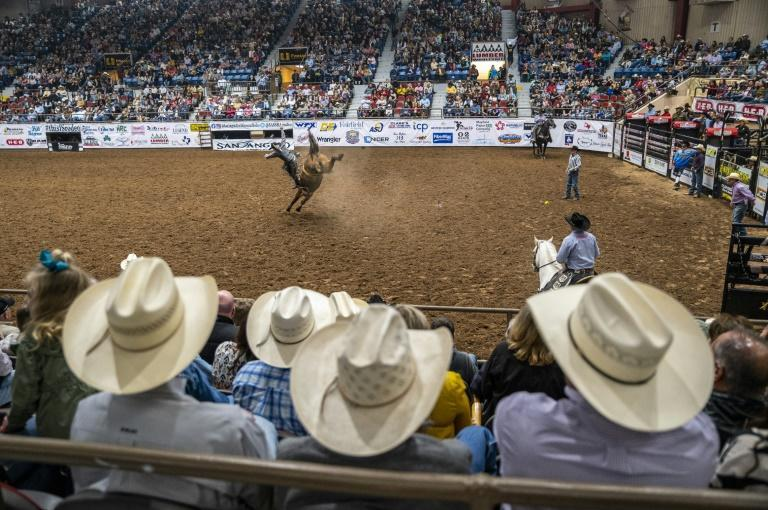 Crowd members look on as a rider is thrown from his horse at the San Angelo Stock Show and Rodeo, April 16, 2021 in San Angelo, Texas