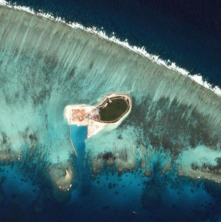Satellite photo shows Chinese-controlled Tree Island, part of the Paracel Islands group in the South China Sea, November 2016.   Planet Labs/via REUTERS