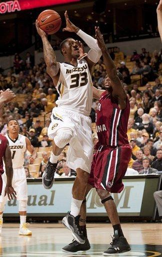 Missouri's Earnest Ross, left, shoots past South Carolina's Bruce Ellington, right, during the first half of an NCAA college basketball game Tuesday, Jan. 22, 2013, in Columbia, Mo. (AP Photo/L.G. Patterson)