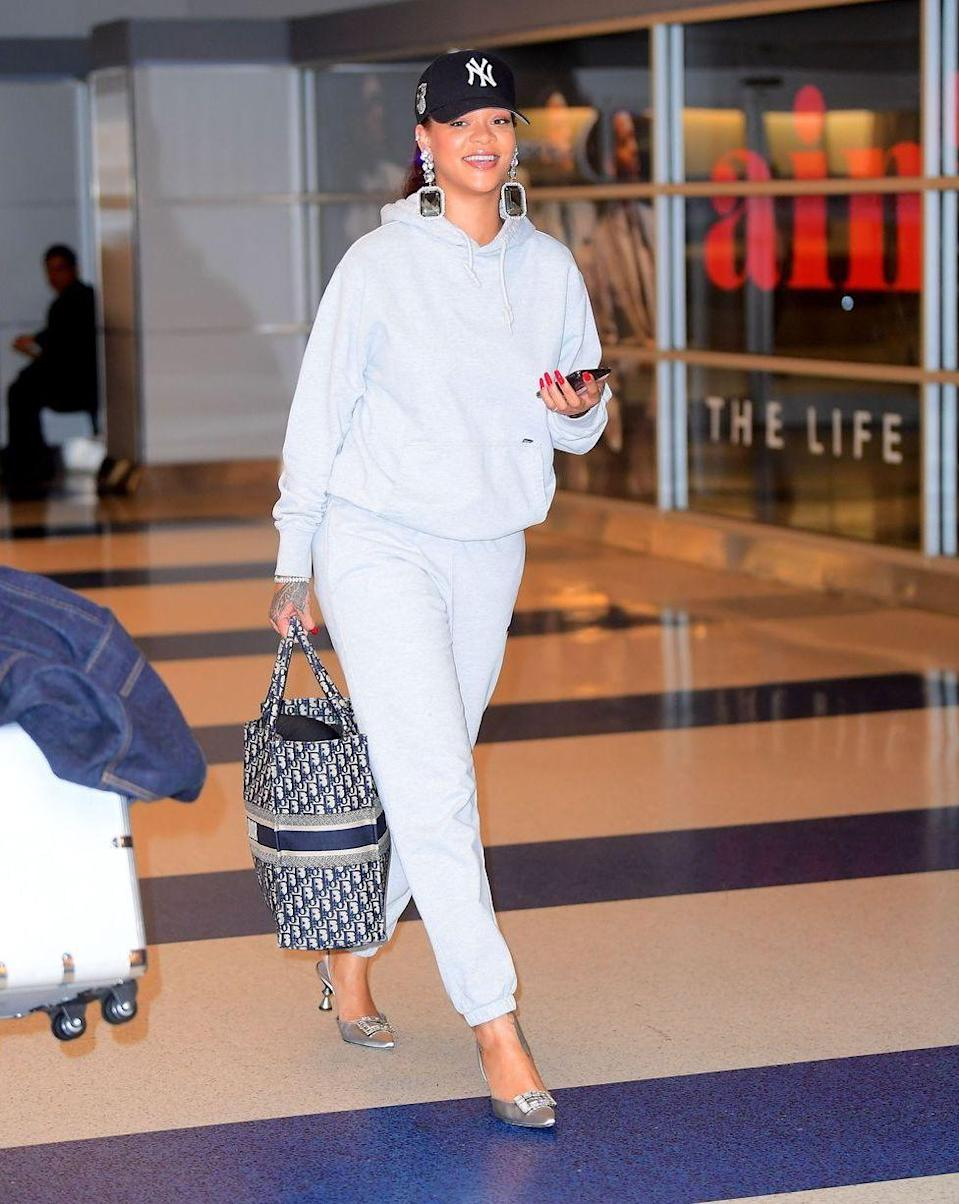 """<p><strong>Rihanna, 2019: </strong>The star touched down at a NYC airport while wearing a sweatsuit set (casual) and a pair of <a href=""""https://www.marieclaire.com/fashion/a28085660/rihanna-manolo-blahnik-heels-sweatpants-airport/"""" rel=""""nofollow noopener"""" target=""""_blank"""" data-ylk=""""slk:Manolo Blahnik silver heels"""" class=""""link rapid-noclick-resp"""">Manolo Blahnik silver heels</a> (not so casual). </p>"""