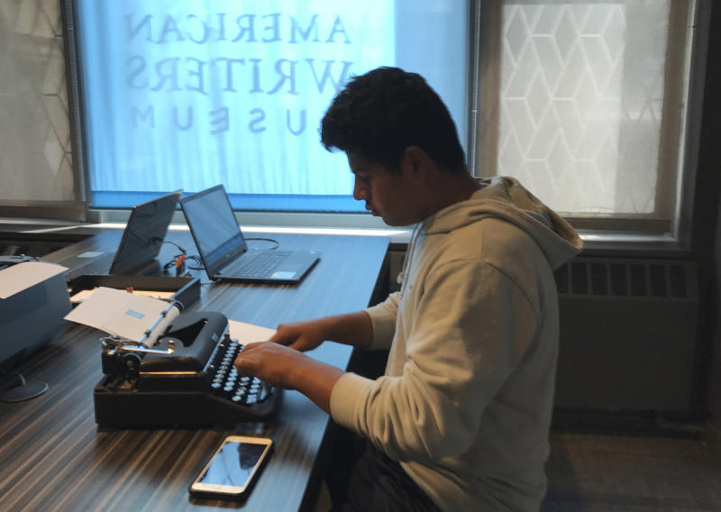 "This Aug. 10, 2017 photo shows a teenage visitor using a typewriter on display at the American Writers Museum in Chicago. A younger generation is discovering the joy of the feel and sound of the typewriter. Two recent documentaries, ""The Typewriter (In The 21st Century)"" (2012) and ""California Typewriter"" (2016), featuring collector Tom Hanks, have helped popularize vintage typewriters among young people, who also have a soft spot for other analog technologies like vinyl records and fountain pens. (AP Photo/Julia Rubin)"