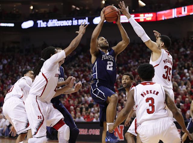 Penn State's D.J. Newbill (2) goes for a layup against the defense of Nebraska players from left: Shavon Shields (31), David Rivers, Benny Parker (3) and Walter Pitchford (35), in the first half of an NCAA college basketball game in Lincoln, Neb., Thursday, Feb. 20, 2014. (AP Photo/Nati Harnik)