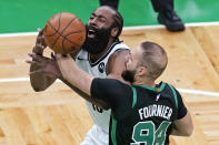 Brooklyn Nets guard James Harden (13) loses control of the ball as Boston Celtics guard Evan Fournier (94) defends during the first quarter of Game 3 in an NBA basketball first-round playoff series, Friday, May 28, 2021, in Boston. (AP Photo/Elise Amendola)