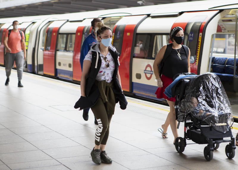 A commuter wears a protective face mask at Stratford station in London, England on June 15th 2020 - The Government enforced a new law which makes it mandatory to wear a protective face masks on all public transport to help stop the transmission of COVID-19 in the UK. (Photo by Jacques Feeney/MI News/NurPhoto via Getty Images)