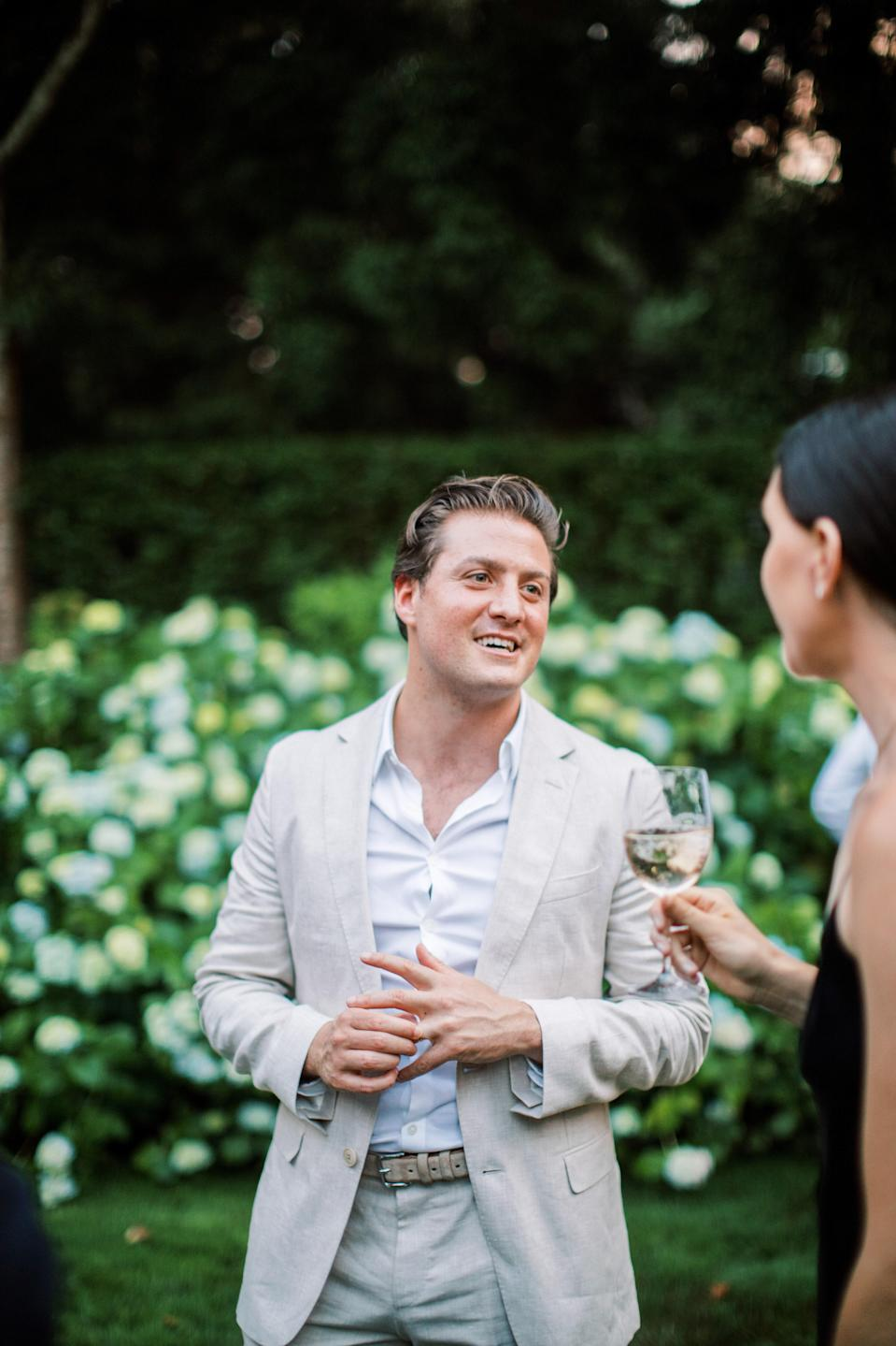 Ben futzing around with his new wedding band while chatting with one of our guests, Samantha. Wearing his ring took some getting used to!
