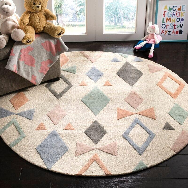 "<br><br><strong>Mack & Milo</strong> Geometric Handmade Tufted Wool Ivory Area Rug, $, available at <a href=""https://go.skimresources.com/?id=30283X879131&url=https%3A%2F%2Fwww.wayfair.com%2Frugs%2Fpdp%2Fmack-milo-geometric-handmade-tufted-wool-ivory-area-rug-w001117404.html%3Fpiid%3D914453056"" rel=""nofollow noopener"" target=""_blank"" data-ylk=""slk:Wayfair"" class=""link rapid-noclick-resp"">Wayfair</a>"