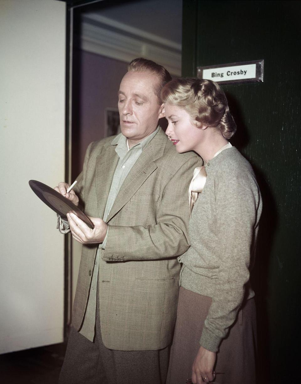 <p>While costarring on <em>The Country Girl </em>together, Kelly receives a signed record from her costar, iconic singer-turned-actor, Bing Crosby. </p>