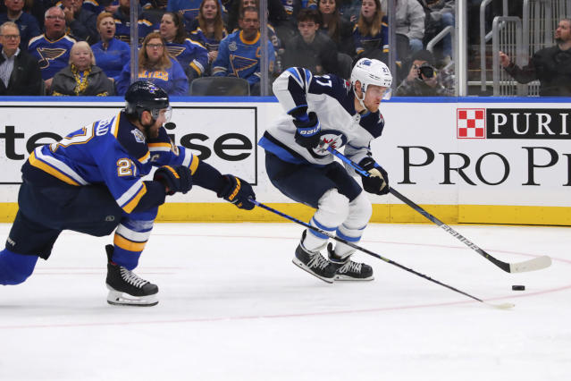 Winnipeg Jets winger Nikolaj Ehlers (27), of Denmark, controls the puck against St. Louis Blues defenseman Alex Pietrangelo (27) during the first period of an NHL hockey game Sunday, Dec. 29, 2019, in St. Louis. (AP Photo/Dilip Vishwanat)