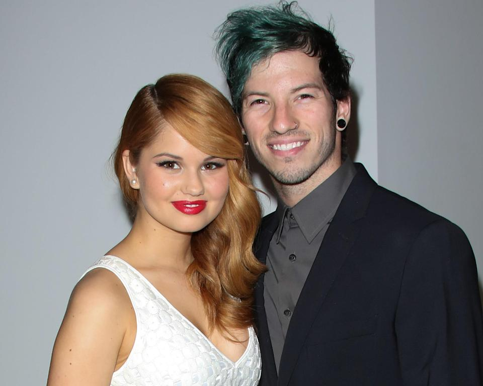 """<p>After getting engaged in December of 2018, actor <a href=""""https://www.glamour.com/story/debby-ryan-spokesperson?mbid=synd_yahoo_rss"""" rel=""""nofollow noopener"""" target=""""_blank"""" data-ylk=""""slk:Debby Ryan"""" class=""""link rapid-noclick-resp"""">Debby Ryan</a> and her partner, Joshua Dun of Twenty One Pilots, <a href=""""https://www.vogue.com/slideshow/debby-ryan-joshua-dun-twenty-one-pilots-wedding?mbid=synd_yahoo_rss&utm_medium=social&utm_source=twitter&utm_social-type=owned&utm_brand=vogue"""" rel=""""nofollow noopener"""" target=""""_blank"""" data-ylk=""""slk:secretly got married"""" class=""""link rapid-noclick-resp"""">secretly got married</a> one year later—and they had planned their wedding in just 28 days. """"We began to flirt with the idea of having a destination party celebrating the new decade, then decided in December to get married [in Austin] on New Year's Eve, and just keep dancing until after the ball dropped,"""" the <em>Insatiable</em> actor told <em>Vogue</em>. """"The time just felt right."""" </p> <p>You can see Ryan's Elie Saab gown and more photos from the big day <a href=""""https://www.vogue.com/slideshow/debby-ryan-joshua-dun-twenty-one-pilots-wedding?mbid=synd_yahoo_rss&utm_medium=social&utm_source=twitter&utm_social-type=owned&utm_brand=vogue"""" rel=""""nofollow noopener"""" target=""""_blank"""" data-ylk=""""slk:here"""" class=""""link rapid-noclick-resp"""">here</a>.</p>"""