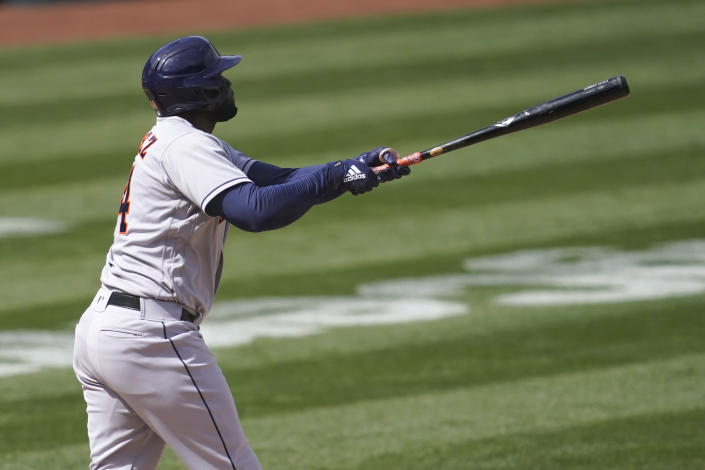 Houston Astros' Yordan Alvarez watches his three-run home run against the Oakland Athletics during the fifth inning of a baseball game in Oakland, Calif., Saturday, April 3, 2021. (AP Photo/Jeff Chiu)
