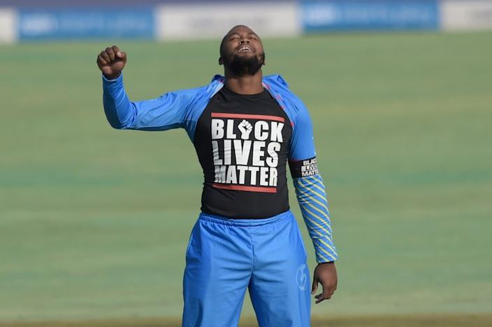 And on Saturday, cricketer Andile Phehlukwayo raises a fist and displays his Black Lives Matter T-shirt as he celebrates on the pitch.