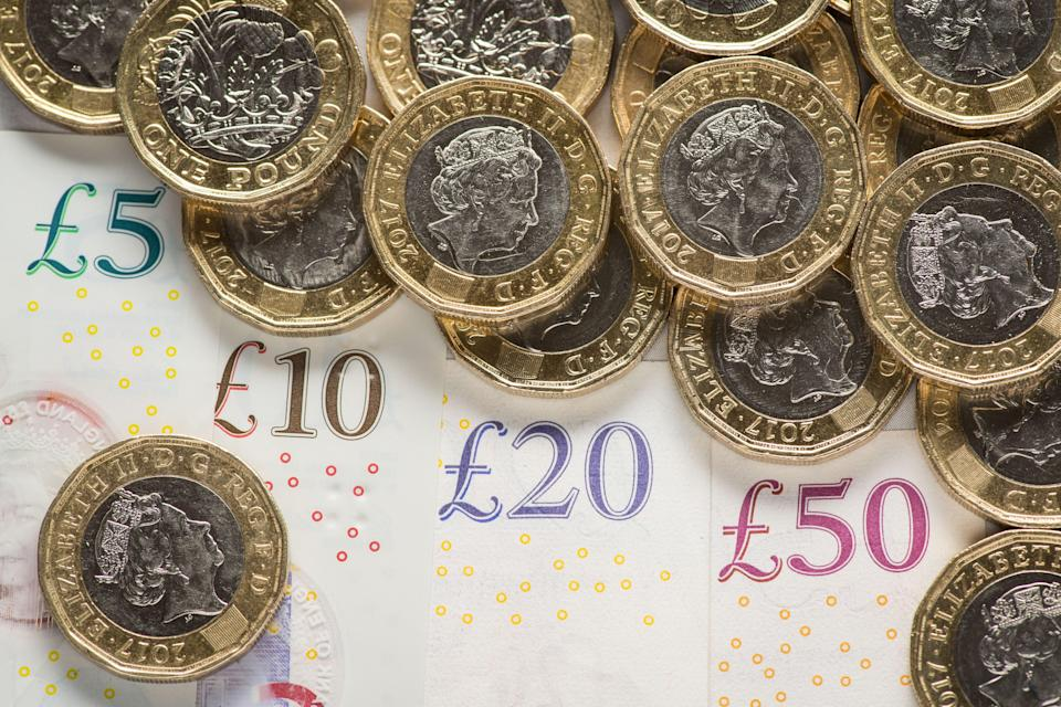 Pound coins and banknotes (PA Archive)