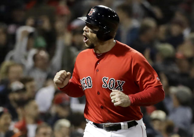 Boston Red Sox's Steve Pearce celebrates after being walked in for a run during the fifth inning in Game 1 of a baseball American League Championship Series against the Houston Astros on Saturday, Oct. 13, 2018, in Boston. (AP Photo/David J. Phillip)