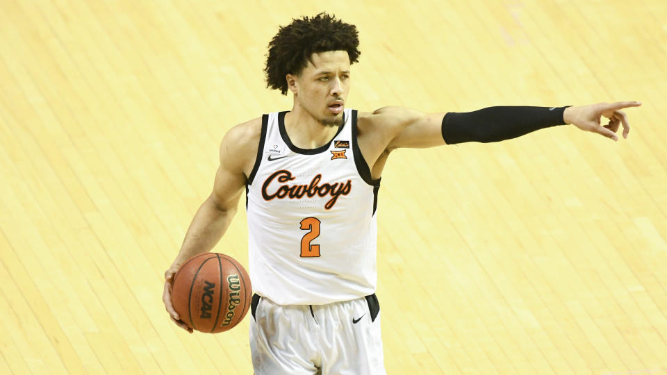 Oklahoma State guard Cade Cunningham (2)points during an NCAA college basketball game Monday, March. 1, 2021, in Stillwater, Okla. (AP Photo/Brody Schmidt)