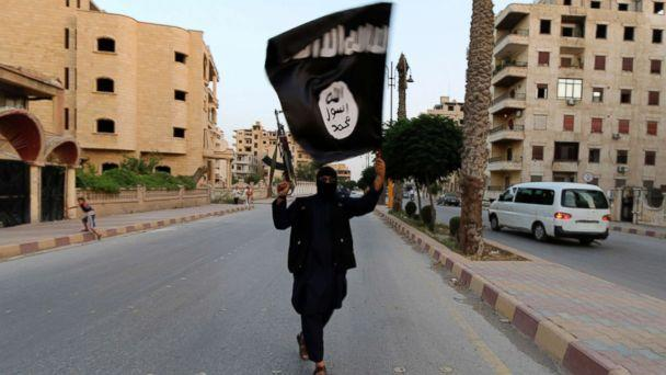 PHOTO: In this file photo, a member loyal to the Islamic State in Iraq and the Levant (ISIL) waves an ISIL flag in Raqqa, Syria, June 29, 2014. (Reuters, FILE)