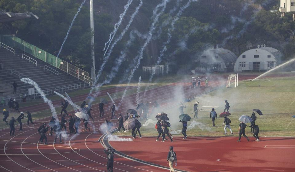 Police fire tear gas into Chinese University campus during a dispersal operation. Photo: Winson Wong