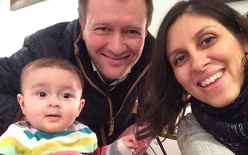 A family photo of jailed British mother Nazanin Zaghari-Ratcliffe with her husband Richard Ratcliffe and their daughter Gabriella - PA