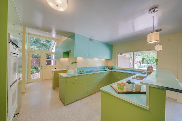 "<div class=""caption""> The dwelling has a unique green kitchen. </div> <cite class=""credit"">Photo: Brandon Valente, Brandon V Photography / Courtesy of Rachelle Rosten, Douglas Elliman</cite>"
