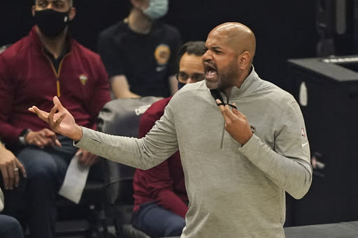 Cleveland Cavaliers head coach J.B. Bickerstaff gives instructions to players in the first half of an NBA basketball game against the Memphis Grizzlies, Monday, Jan. 11, 2021, in Cleveland. (AP Photo/Tony Dejak)